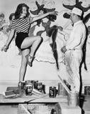 Dancing woman posing for mural painter Stock Images