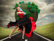 Dancing woman in a red and black dress Stock Photos