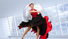 Dancing woman in a red and black dress Royalty Free Stock Images