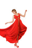 Dancing woman in red dress Stock Images