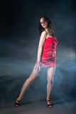 Dancing woman in red dress on black background Royalty Free Stock Photo