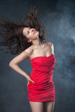 Dancing woman in red dress on black background Royalty Free Stock Image