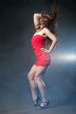 Dancing woman in red dress on black background Stock Image