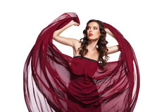 Dancing woman in red dress flying on wind. Dancing woman in red dress waving flying on wind flow with long curly hair over white Stock Photos