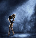 Dancing Woman, Sexy Girl Posing in Expressive Sport Dance. Fitness Dancer Athletic Body, Artist over blue grunge background Royalty Free Stock Image