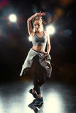 Dancing woman in sportive clothing Royalty Free Stock Photo