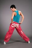 Dancing woman in sportswear behind Stock Photo