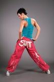 Dancing woman in sportswear behind Stock Photo