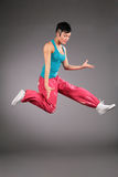 Dancing woman in sportswear in  jump Royalty Free Stock Photography