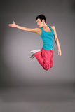 Dancing woman in sportswear in jump Royalty Free Stock Photos