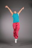 Dancing woman in sportswear  jumps Stock Photo