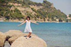 Dancing Woman on Stone Stock Photo