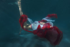 Dancing woman underwater. Royalty Free Stock Images