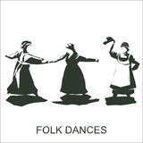 Dancing women in traditional dress. Silhouette of dancing women in traditional dress Royalty Free Stock Photo