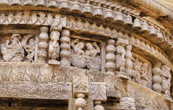 Dancing women of traditional Indian carved Hindu temple. Ancient people figures and patterns on wooden wall of old India Stock Photography