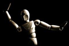 Dancing wooden artist's mannequin. A dancing wooden artist's mannequin in sepia tones stock images