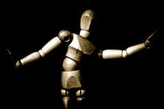 Dancing wooden artist's mannequin. A dancing wooden artist's mannequin in sepia tones stock photo