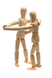 Dancing wooden dolls. On white Stock Photos