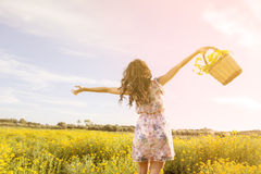 Dancing with yellow daisies in a field warm filter applied Royalty Free Stock Photography