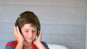 Dancing young boy enjoying music with headphones Stock Photography