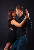 Dancing young couple Stock Image