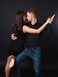 Dancing young couple Stock Photos