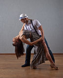 Dancing young couple Royalty Free Stock Images
