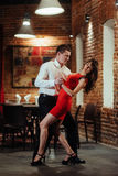 Dancing young couple on a white background. Passionate salsa. Royalty Free Stock Photos