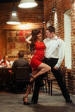 Dancing young couple on a white background. Passionate salsa. Royalty Free Stock Photography