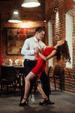 Dancing young couple on a white background. Passionate salsa. Royalty Free Stock Image