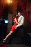 Dancing young couple on a white background. Passionate salsa. Stock Photography