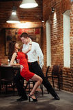 Dancing young couple on a white background. Passionate salsa dan Royalty Free Stock Image