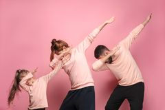 The dancing young family on pink royalty free stock photos
