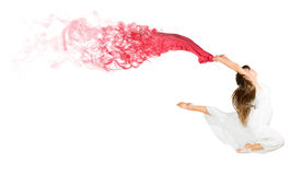 Dancing young girl with red cloth Stock Photos