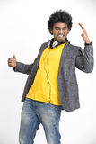 Dancing young Indian young urban man with headphone. On white background Stock Photos