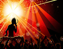 Dancing young people in the nightclub. Festive party in the nightclub with DJ Royalty Free Stock Photos