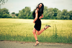 Dancing young woman Stock Photography