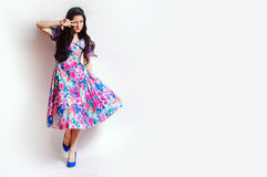 Dancing young woman in a bright pin-up dress Stock Photography