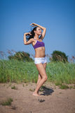 Dancing young woman. Outdoors. Royalty Free Stock Photos