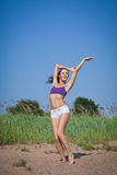 Dancing young woman. Outdoors. Royalty Free Stock Image