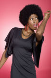 Dancing young woman over colored background royalty free stock photo