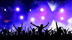 Dancing youth party, illustration. Crowd of cheerful people at a concert. Silhouettes of a crowd of fans in front of bright scene lights royalty free stock photography