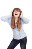 dancingowa dziewczyna słucha muzycznych potomstwa Fotografia Royalty Free