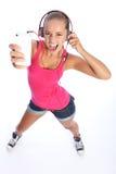 dancingowego zabawy dziewczyny muzycznego telefonu seksowny nastoletni Fotografia Royalty Free