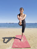 Dandayamana janushirasana frontal pose at beach Stock Photography