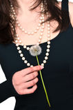 Dandelion. Beautiful woman with dandelion in the hand Royalty Free Stock Image