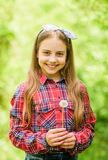 Dandelion is beautiful and full of symbolism. Summer is here. Summer garden flower. Girl cute teen dressed country. Rustic style checkered shirt nature stock image
