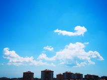 buildings and clouds in the sky royalty free stock image