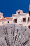 Dandelion fountain and houses at Mali Losinj Stock Photos
