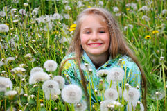 Dandelion and the girl Royalty Free Stock Image